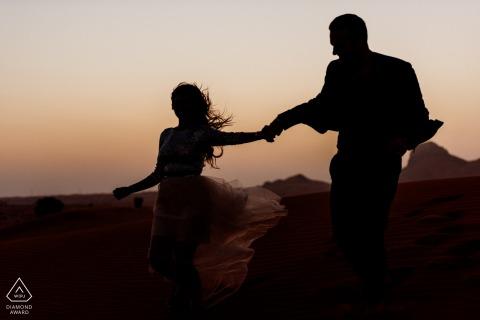 UAE engagement photoshoot & pre-wedding session at Maleiha Desert, Dubai as it is getting dark in the desert