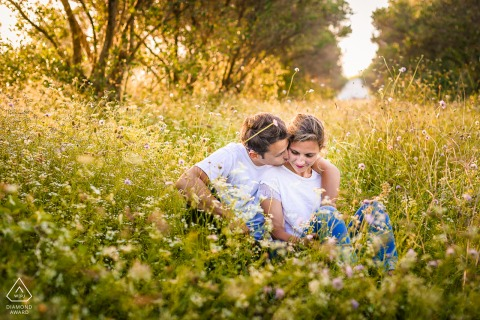 FR pre wedding and engagement photography in France with a loving couple In the meadows