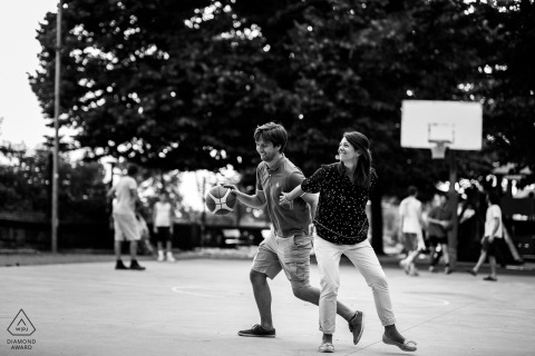 IT pre-wedding photo session with an engaged couple during a Trieste, Italy Basketball themed engagement shoot