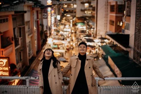 Vietnam urban city engagement photoshoot & pre-wedding session high above the nightlife of Dalat