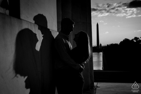 DC engagement portrait with a posed couple throwing shadows at Lincoln Memorial	Washington DC