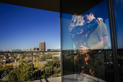 Phoenix, Arizona couple at their home reflected in glass during pre-wed engagement photo shoot