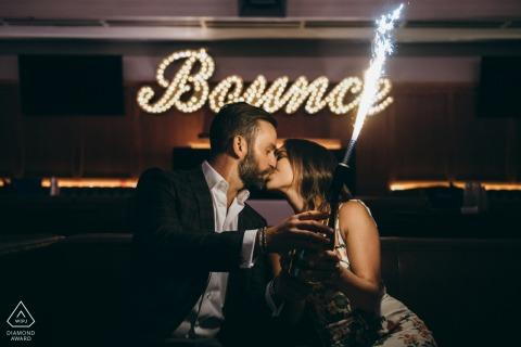 Bounce Bar, Chicago engagement portrait of couple with a sparkler lit bottle
