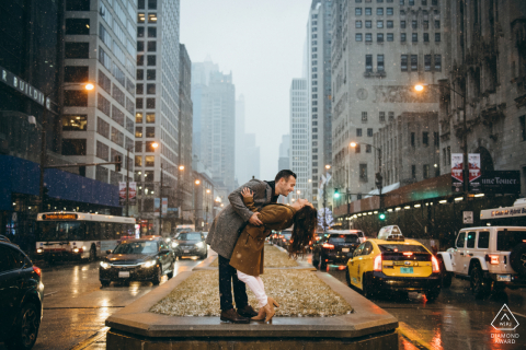 Michigan Ave pre-wed image session with a couple Laughing in Snow and Traffic