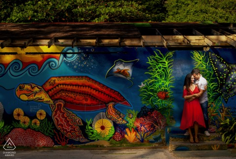 Tunel Guajataca engagement photography of a couple against a sealife mural in Isabela, Puerto Rico