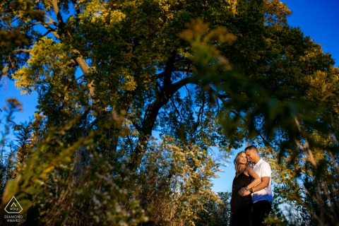 chicago lincoln park engagement session with a single light under the tall trees