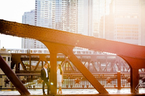 chicago downtown engagement session on the bridge with warm afternoon sunlight