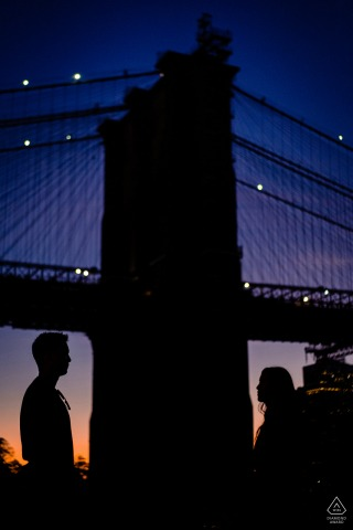 Dumbo Silhouette NY during a pre-wed picture session at dusk by the bridge