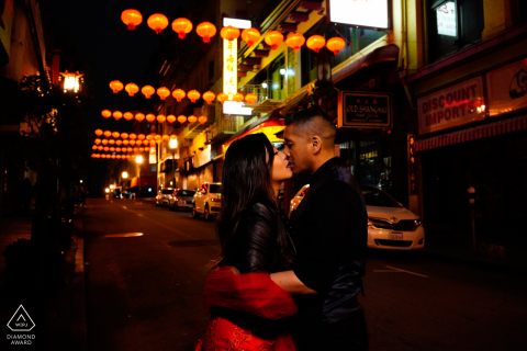 Chinatown, San Francisco, CA 	Sharing a kiss at nighttime in Chinatown