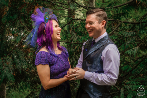 Hoyt Arboretum, Portland, Oregon couple laughs together - you can see the joy on their faces during a pre-wed picture session