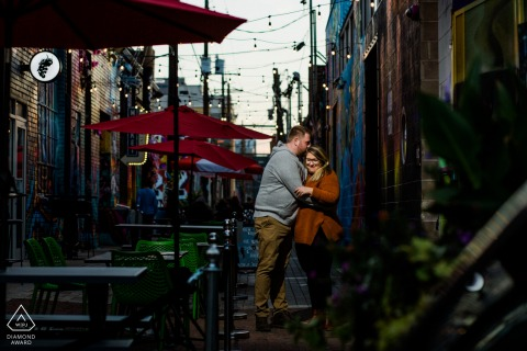 Rino District in Denver Couple kissing in alley during a pre-wed photography shoot