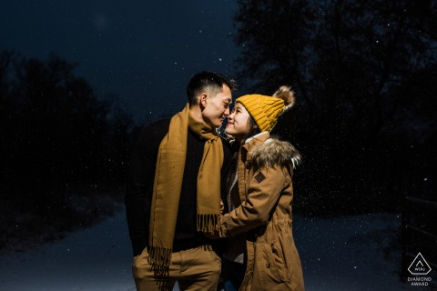 Lair o Bear Park Couple kissing in snow during a pre-wed photography session
