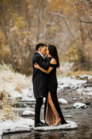 Lair O Bear Park Couple kissing by water during a winter pre-wed photo session
