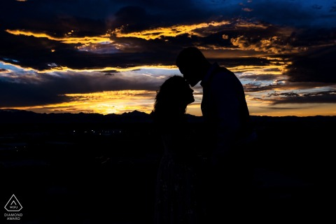 Acreage by Stem Ciders, Lafayette, CO couple silhouetted in front of sunset during an engagement pre-wed photography session