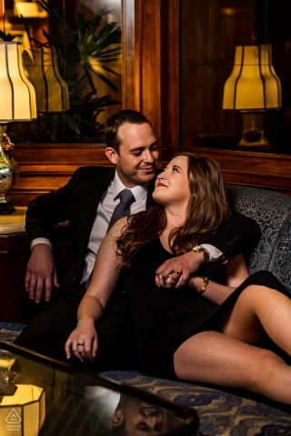 Brown Palace, Denver, CO couple poses in hotel lobby during an artistic engagement photography session