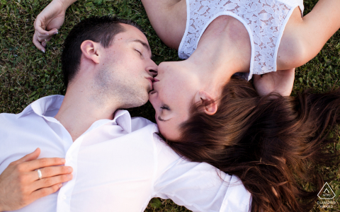 Marciac, Gers, France couple on grass kissing, shot from above, for a creative engagement shoot