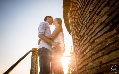 Marciac, Gers, France couple kissing with the sunset for a creative engagement portrait