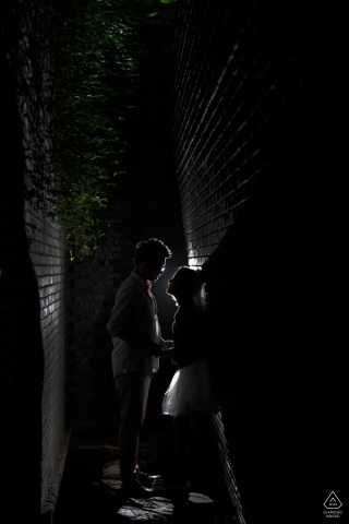 Red brick art gallery Love during an engagement portrait shoot under light and shadow