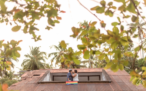 Marechal Deodoro, Alagoas couple hold a movement flag and kisses during an engagement portrait session