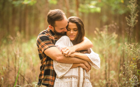 Atalaia, Alagoas couple embraces affectionately near the woods during an engagement portrait session