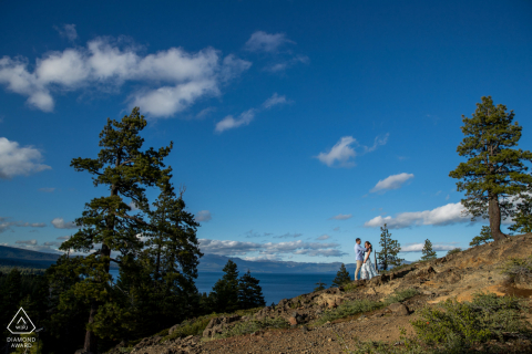 West Lake Tahoe Couple at top of rock sharing a moment during a pre-wed shoot