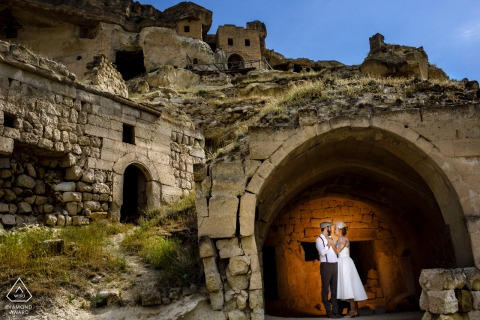 Turkey engagement photo session in formal dress under an arch with a light