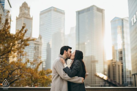 Wrigley Building Chicago photo shoot with Sun shining through downtown in a creative pre-wedding session