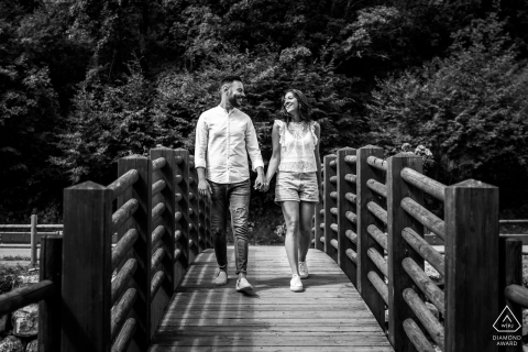 Lago di Scanno, Abruzzo, Italy couple Walking over the bridge for their engagement pre-wed photos