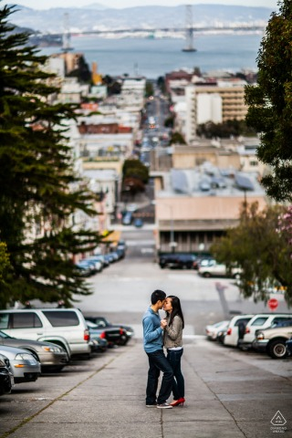San Francisco Romance pre-wed portrait session on a steep city street with awesome view of the bay