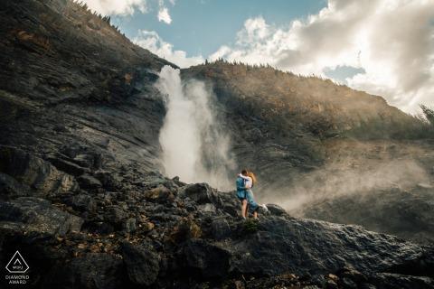 Engagement pre-wed photo shoot at Takakkaw Falls, BC, Canada with a hug at the waterfalls