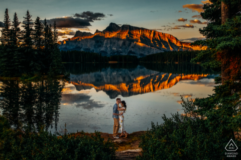 Two Jacks Lake, AB, Canada	Sunrise engagement photo shoot with beautiful mountain reflections on the water