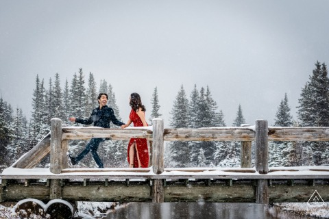Engaged couple at Bow Lake, AB, Canada Having fun in the snow during picture session