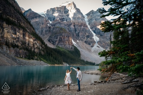 A couple at Moraine Lake, Banff National Park, AB, Canada	 are Having a good time during their pre-wed photo session