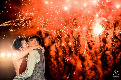 Banyan Tree Ungasan Bali couple were kissing during a pre-wed photo session while the fireworks were playing