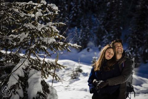 Courchevel outside forest picture session before the wedding day of a couple in a wintery forest