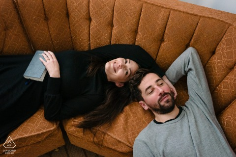 Montreal small indoor photo session with the couple before the wedding day with a couple lounging on a couch
