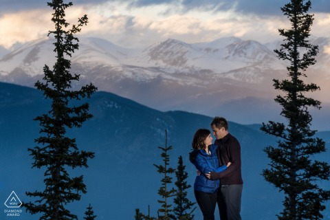 Evergreen, CO outdoor engagement photo session before the wedding with a Couple at sunset in the mountains