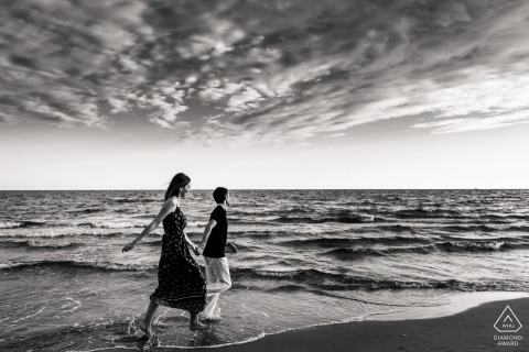 Montpellier, France mini beach couple photography session before the wedding while walking in the water and sand