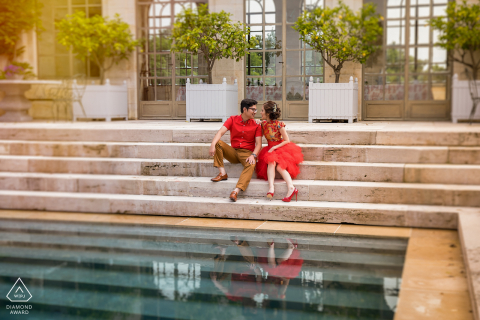 Chateau du Tertre, Bordeaux, France photo session with the engaged couple kissing near the swimming pool
