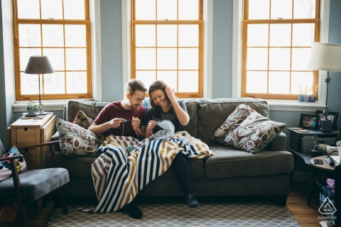 Chicago engagement photo session with the Couple Knitting in their home before the wedding day