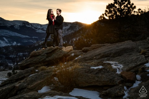Rocky Mountain National Park micro outdoor mountain photo session before the wedding day with a couple enjoying the sunset on a peak