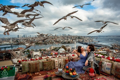 Suleymaniye, Istanbul, Turkey mini urban pic shoot before the wedding day on the roof with birds flying overhead near the clouds