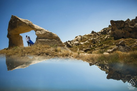Cappadocia, Turkey mini couple photo session before the wedding day with a mirror sunrise reflection on the rocks