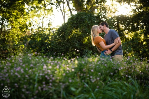 Fort Collins, Colorado pre wedding couple session in nature  in the summer greenery with the golden light of the evening sun