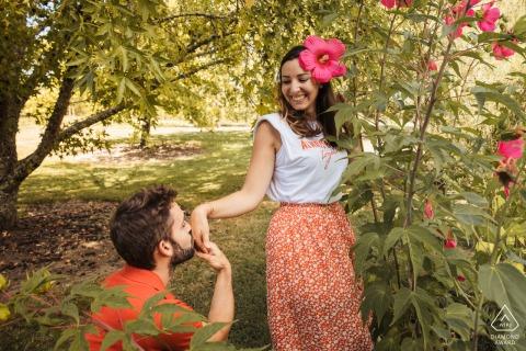 Jardin de Coursiana pre wedding portrait in the garden as the man kneels down and kisses her hand