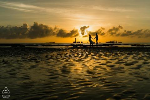 Maceió beach couple portrait as a silhouette at sunrise