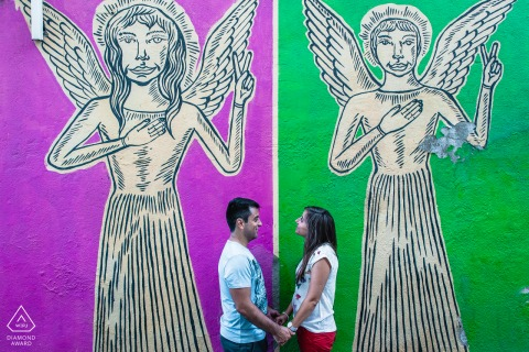 Alfama, Lisboa artistic pre wedding portrait shoot with some urban art as their backdrop