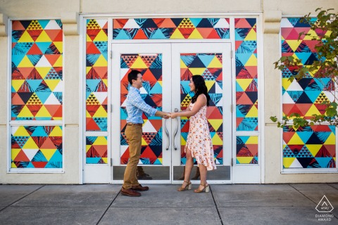 Los Gatos couple shoot in front of a colorful window and door display