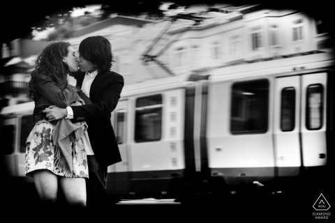 San Francisco black and white couple portrait as the metro train passes by