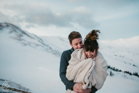 Loveland Pass, COcouple session of snuggling together to stay warm at 11k feet